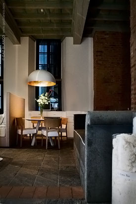 Oluce lamps for the new Elite showroom in Milan