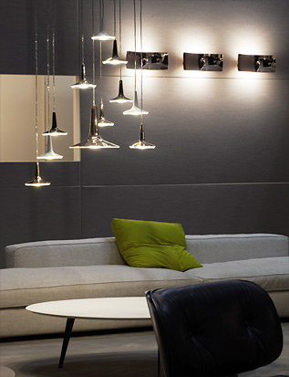Oluce introduce in its collection the multiple ceiling bar/plate
